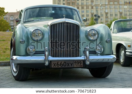 MOSCOW - JULY 31: Bentley R Type Continental (1954) on exhibition parking at an annual event, the VI race of vintage cars 'Night Moscow Classic Rally'. July 31, 2010 in Moscow, Russia - stock photo