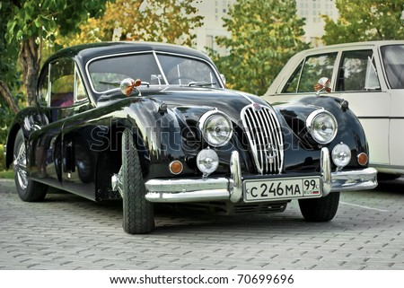 MOSCOW - JULY 31: Black Jaguar XK120 Classic on exhibition parking at an annual event the VI race of vintage cars 'Night Moscow Classic Rally'. July 31, 2010 in Moscow, Russia - stock photo