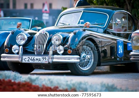 MOSCOW - JULY 31: Black Jaguar XK120 Classic on exhibition parking at an annual event the VI race of vintage cars 'Night Moscow Classic Rally on July 31, 2010 in Moscow, Russia - stock photo
