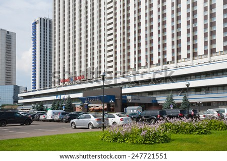"MOSCOW - JULY 24: Car parking near ""Izmailovo"" hotel complex on July 24, 2014 in Moscow. - stock photo"