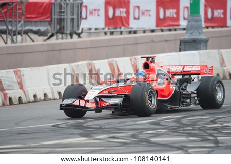 MOSCOW - JULY 15: Charles Pic of Marussia F1 Racing at Moscow City Racing 2012 at Kremlin embankment July 15, 2012 in Moscow - stock photo