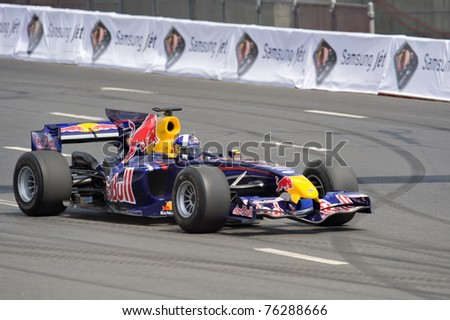 MOSCOW - JULY 19: David Coulthard of Red Bull Racing at Bavaria Moscow City Racing 2009 at Kremlin embankment July 19, 2009 in Moscow - stock photo