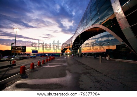 MOSCOW - JULY 7: Domodedovo airport at sunset on July 7, 2010 in Moscow, Russia. Domodedovo airport is Russia's largest airport, is also included in the twenty largest airports in Europe. - stock photo