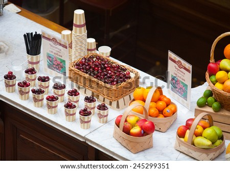 MOSCOW - JULY 29: Fruits and berries lying on the counter in the GUM store on July 29, 2014 in Moscow. - stock photo