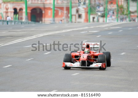MOSCOW - JULY 17: Giancarlo Fisichella of Scuderia Ferrari at Bavaria Moscow City Racing 2011 at Kremlin embankment July 17, 2011 in Moscow. - stock photo