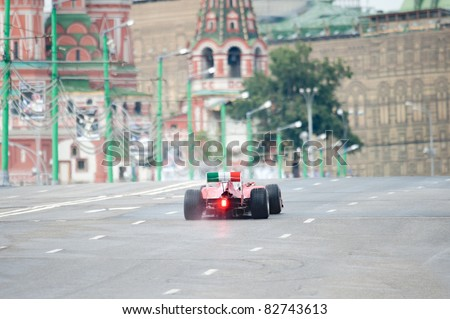 MOSCOW - JULY 17: Giancarlo Fisichella of Scuderia Ferrari competes at the Bavaria Moscow City Racing 2011 at Kremlin embankment on July 17, 2011 in Moscow, Russia. - stock photo