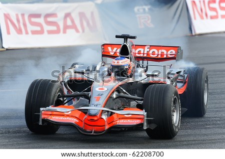 MOSCOW - JULY 18: Jenson Button of McLaren Mercedes at Bavaria Moscow City Racing 2010 at Kremlin embankment July 18, 2010 in Moscow. - stock photo
