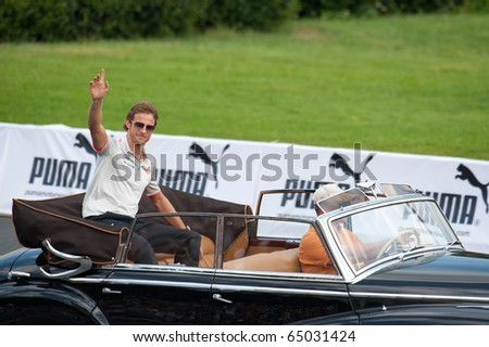 MOSCOW - JULY 18: Jenson Button of McLaren Mercedes at Bavaria Moscow City Racing 2010 at Kremlin embankment on July 18, 2010 in Moscow, Russia. - stock photo