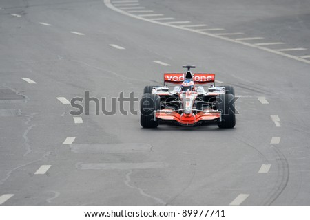 MOSCOW - JULY 18: Jenson Button of McLaren Mercedes competes at the Bavaria Moscow City Racing 2010 at Kremlin embankment on July 18, 2010 in Moscow, Russia - stock photo