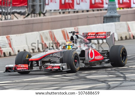 MOSCOW - JULY 15: Lewis Hamilton of McLaren Mercedes at Moscow City Racing 2012 at Kremlin embankment July 15, 2012 in Moscow - stock photo