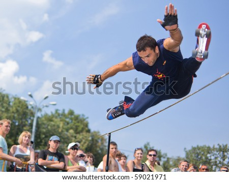 MOSCOW - JULY 31: Luzhniki Olympic arena, Dmitry Podgorny performs a jump - Annual Russian Rollerskating Federation Contest on July 31, 2010 in Moscow - stock photo