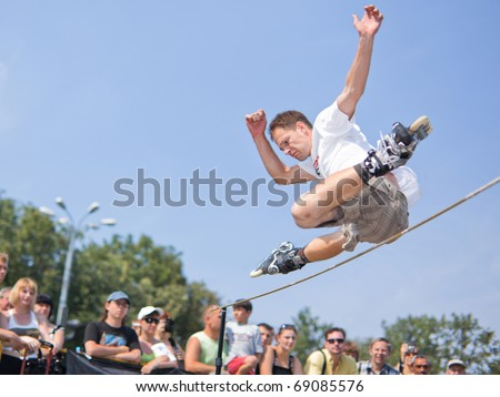 MOSCOW - JULY 31: Luzhniki Olympic arena, Kiryll Ryazantsev performs a jump - Annual Russian Rollerskating Federation Contest on July 31, 2010 in Moscow - stock photo