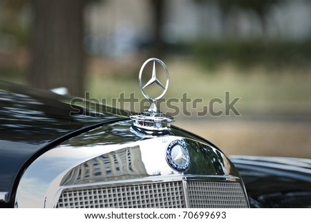 MOSCOW-JULY 31: Mercedes-Benz emblem. Annual event 'Night Moscow Classic Rally', - the VI race of vintage cars, more than 50 crews, from owners to celebrities.  July 31, 2010 in Moscow, Russia - stock photo