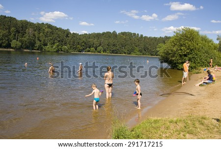 MOSCOW - JULY 20, 2014: people have fun on beach in Serebryany bor (Silver forest) on Moskva-river, one of the most popular beaches of the city. - stock photo