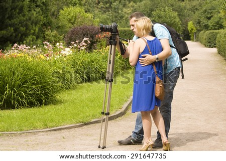 MOSCOW - JULY 15, 2014: people take pictures of flowers in rosarium in park Sokolniki, park founded in 1878 in hunting area of Russian kings near Moscow. - stock photo