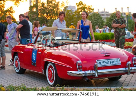 MOSCOW-JULY 31: Red Mercedes-Benz 190 SL at the VI race of vintage cars 'Night Moscow Classic Rally'. July 31, 2010 in Moscow, Russia - stock photo