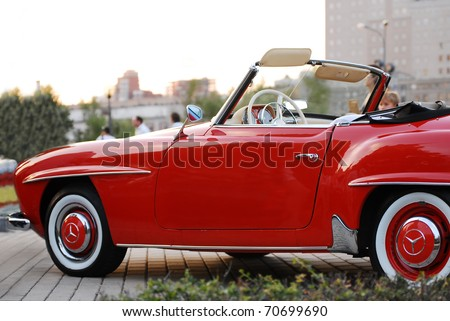 MOSCOW-JULY 31: Red Mercedes-Benz 190 SL on exhibition parking at an annual event, the VI race of vintage cars 'Night Moscow Classic Rally'. July 31, 2010 in Moscow, Russia - stock photo