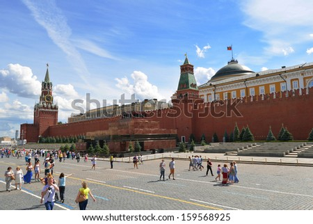 MOSCOW - JULY 18:Red Square, Lenin mausoleum and Spasskaya Clock tower.People visiting the Red Square on july 18, 2013 in Moscow, Russia. The Red Square are the main attractions in Moscow. - stock photo