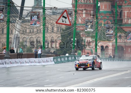 MOSCOW - JULY 17: Sebastien Ogier and Julien Ingrassia of Citroen World Rally Team at Bavaria Moscow City Racing 2011 at Kremlin embankment July 17, 2011 in Moscow. - stock photo