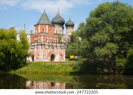 MOSCOW - JULY 24: The Tower Bridge and trees on the shore of a pond in Izmailovo Park on July 24, 2014 in Moscow. - stock photo