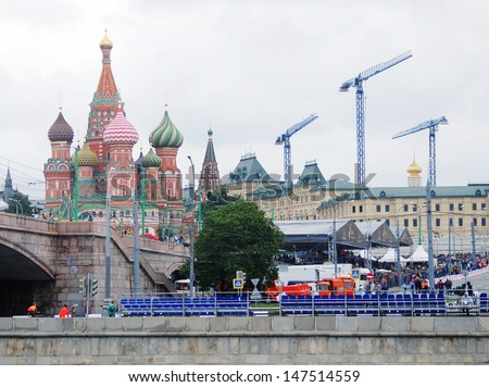 MOSCOW - JULY 21: Tribunes at Moscow City Racing. Formula 1 teams show in historical city center of Moscow. Saint Basil church at left. Taken on July 21, 2013 in Moscow, Russia.  - stock photo