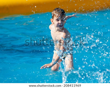 MOSCOW - JULY 26: Unidentified boy age 6-8 years plays in the pool during Moscow City Games in Luzhniki on July 26, 2014 in Moscow.