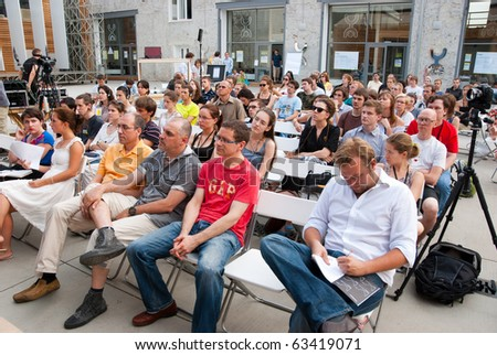 """MOSCOW - JULY 10: Unidentified people listen to a lecture at workshop """"The Future of Labor and the City"""" in """"Strelka Institute"""" on July 10, 2010 in Moscow, Russia - stock photo"""