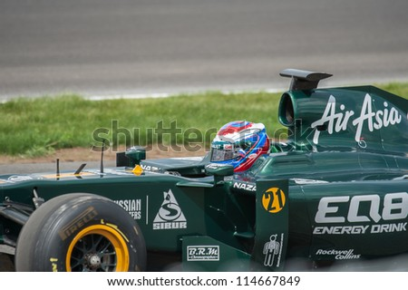 """MOSCOW - JULY 14: Vitaly Petrov of Caterham F1 Team at opening new circuit """"Moscow Raceway"""" July 14, 2012 in around Moscow, Russia - stock photo"""