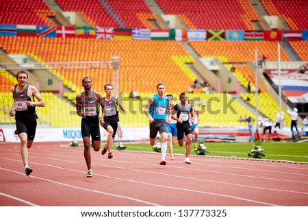 MOSCOW - JUN 11: Athletes run on track of Grand Sports Arena of Luzhniki Olympic Complex at International athletics competitions IAAF World Challenge Moscow Challenge, June 11, 2012, Moscow, Russia. - stock photo