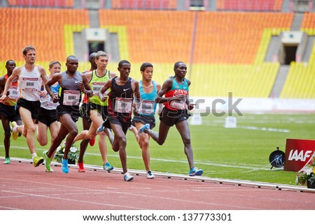 MOSCOW - JUN 11: Group of runners on race track at Grand Sports Arena of Luzhniki OC during International athletics competitions IAAF World Challenge Moscow Challenge, June 11, 2012, Moscow, Russia. - stock photo