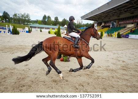MOSCOW - JUN 9: Rider on horse at international competitions in show jumping CSI3 Vivat, Russia in equestrian center Bitsa, June 9, 2012, Moscow, Russia. Prize fund of competition was 114 500 euros. - stock photo