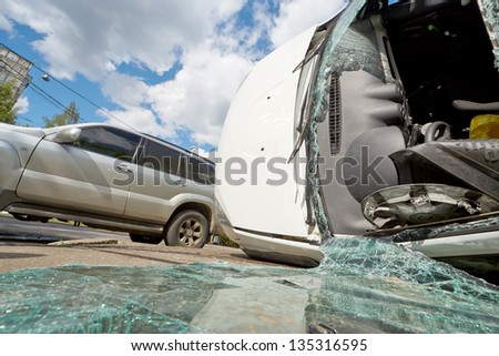 MOSCOW - JUN 4: Serious car accident at intersection of Pogonny passage and 1-st Podbelsky passage, Jun 4, 2012, Moscow, Russia. Both cars and the driver of Renault suffered. - stock photo