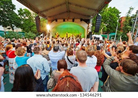 MOSCOW - JUN 23: Vladimir Shahrin and Chaif rock-band perform on stage in Hermitage Garden during VII traditional festival of live sound Music of Summer, Jun 23, 2012, Moscow, Russia. - stock photo