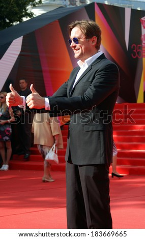 MOSCOW - JUNE 20, 2013: Actor Artyom Mikhalkov at XXXV Moscow International Film Festival red carpet opening ceremony.