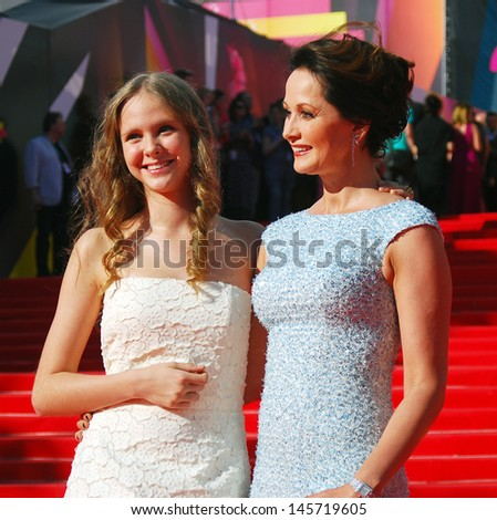 MOSCOW - JUNE 20: Actress Olga Kabo with her daughter at XXXV Moscow International Film Festival red carpet opening ceremony. Taken on June 20, 2013 in Moscow, Russia.