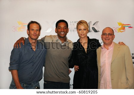 MOSCOW - JUNE 19: Akiva Goldsman, Peter Berg, Charlize Theron, Will Smith at the press conference, prior to the Russian premiere of 'Hancock' on 30 Moscow film festival on June 19, 2008 in Moscow. - stock photo