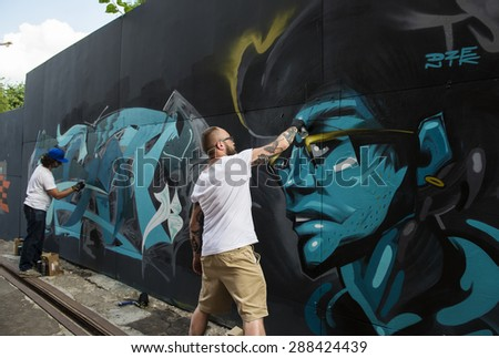 "MOSCOW - JUNE 14, 2015: Art-pad ""Flacon"". Street artist painting graffiti. - stock photo"