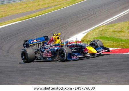 MOSCOW - JUNE 23: David Marshall Coulthard makes a show on a Formula 1 Red Bull Infiniti car at World Series by Renault in Moscow Raceway on June 23, 2013 in Moscow - stock photo