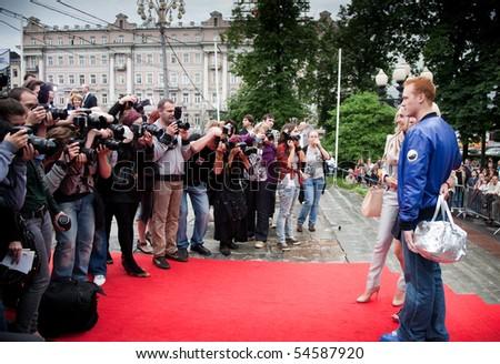 "MOSCOW - JUNE 1: E. fon Gechmen-Valdek, Oksana Pushkina with son.  Premiere of  ""Sex and the City 2"",  June 1, 2010 in the Phushkinsky cinema, Moscow, Russia - stock photo"
