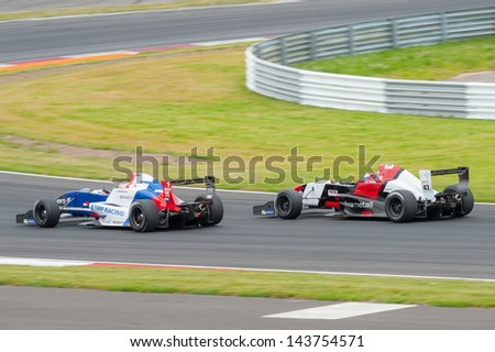 MOSCOW - JUNE 23: Egor Orudzhev (left) of Tech 1 R team (FRA) and Hans Willemi (right) of Atech Reid Team (GBR) races at World Series by Renault in Moscow Raceway on June 23, 2013 in Moscow - stock photo