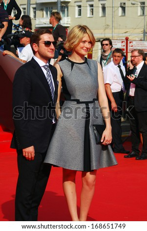MOSCOW - JUNE 29: Film director Rezo Geginieshvily with his wife, actress Nadezhda Mikhalkova at XXXV Moscow International Film Festival red carpet closing ceremony. Taken on June 29, 2013 in Moscow.