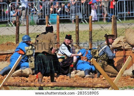 MOSCOW - JUNE 08, 2014: First World War battle historical reenactment. Times and Ages International Historical Festival in Kolomenskoye park, Moscow.