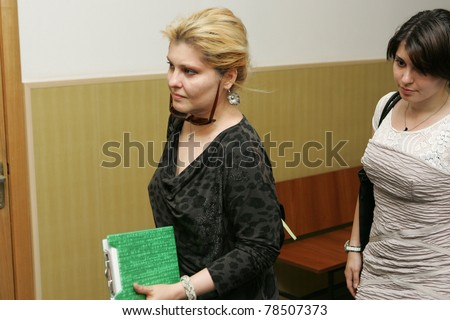 MOSCOW - JUNE 2: Former oil tycoon Mikhail Khodorkovsky's wife Inna, left, and daughter Anastassiya walk to a court room June 2, 2011 in Moscow, Russia.