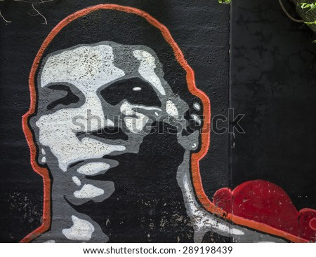 MOSCOW - JUNE 21, 2015: Graffiti on a urban wall (near B. Novodmitrovskaya street). Mike Tyson portrait. - stock photo