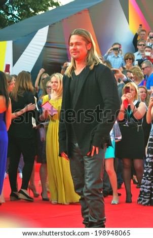 MOSCOW - JUNE 20, 2013: Hollywood Actor Brad Pitt at XXXV Moscow International Film Festival red carpet opening ceremony. He presents the premiere of the movie World War Z. - stock photo