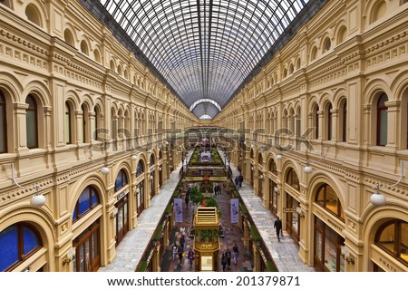 MOSCOW - JUNE 18, 2014: Inside famous GUM the large store in the Kitai-gorod part of Moscow facing Red Square. It is currently a shopping mall. - stock photo