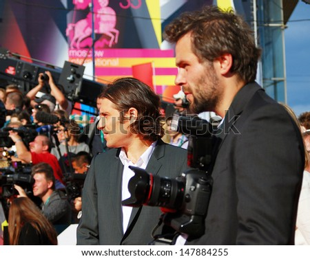 MOSCOW - JUNE 20: Jeremy Kleiner (at left), a film producer, at 35 Moscow International Film Festival red carpet opening. He presents his recent movie World War Z. Taken on June 20, 2013 in Moscow. - stock photo