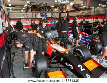 MOSCOW - JUNE 23: Mechanics prepare formula car for Formula Renault 2.0 race at World Series by Renault in Moscow Raceway on June 23, 2013 in Moscow - stock photo