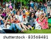 "MOSCOW - JUNE 5: People attend open-air concert at the VIII International Jazz Festival ""Usadba Jazz"" in ""Archangelskoye Mansion"" on June 5, 2011 in Moscow - stock photo"