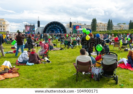 """MOSCOW - JUNE 3: People attend open-air concert on IX International Jazz Festival """"Usadba Jazz"""" in """"Archangelskoye Mansion"""" on June 3, 2012 in Moscow - stock photo"""